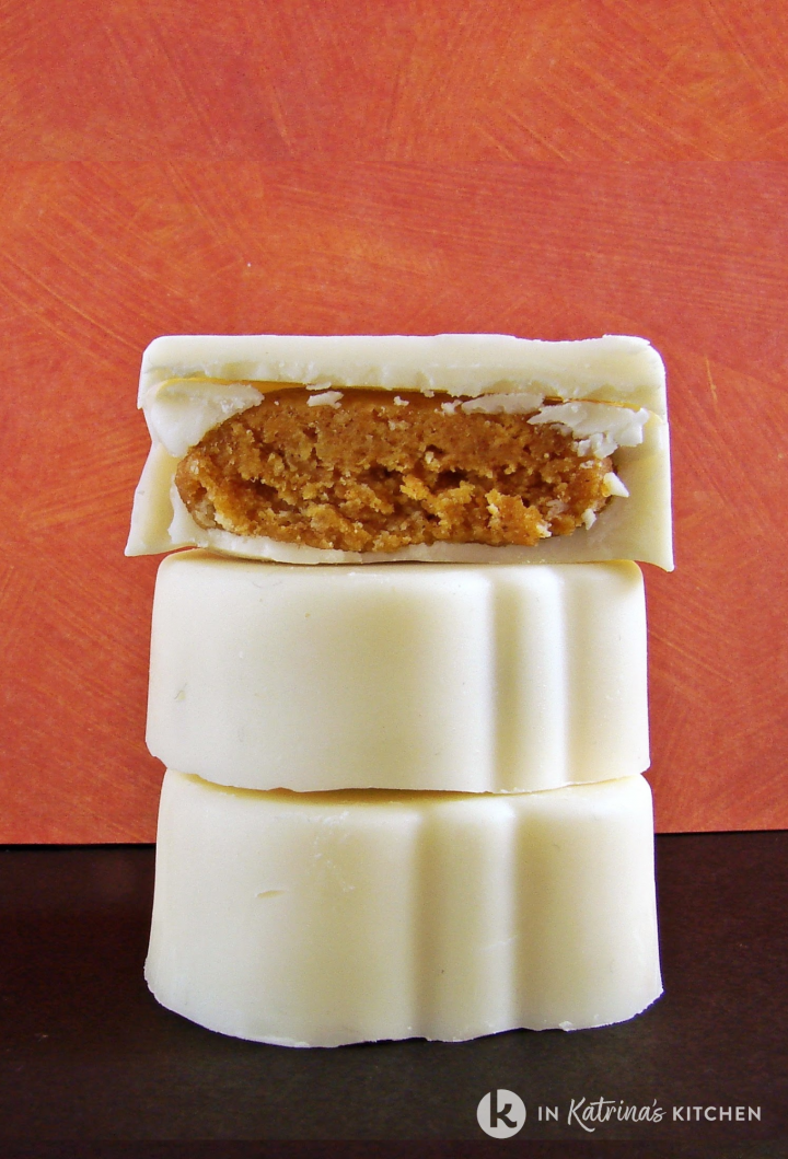 three candies stacked on top of one another with the top one cut in half to expose the filling