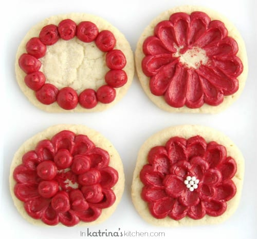 4 steps to making a sugar cookie look like a flower by dragging drops of frosting toward the center