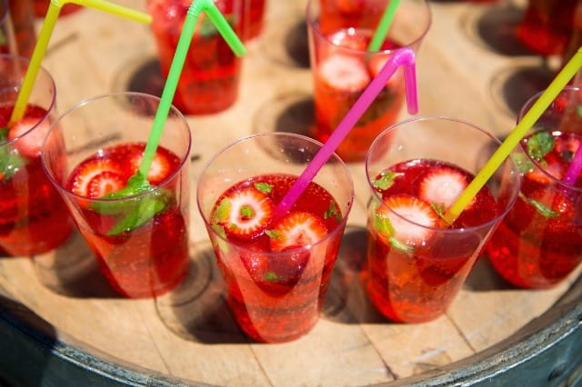 Strawberry Italian soda with rosemary syrup–sweet bubbly & reminiscent of summer