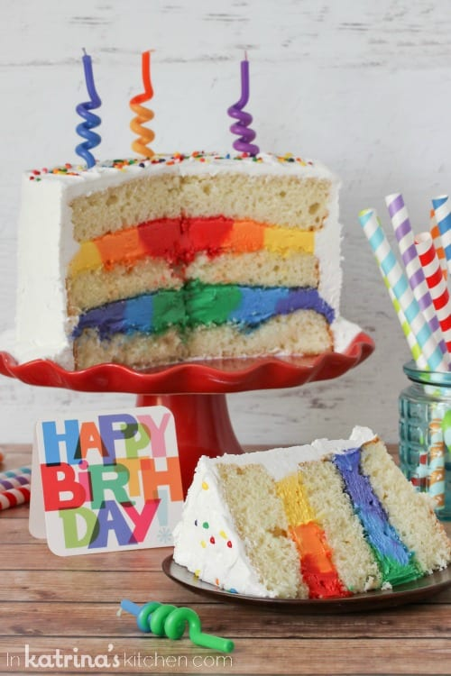 Extra Rich Vanilla Cake Recipe with Rainbow Frosting- this impressive cake is easy to make!