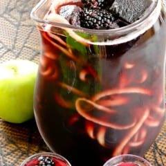 An awesome use for your spirializer! Make long strips of apples into this Blackberry Apple Spooky Sangria Recipe