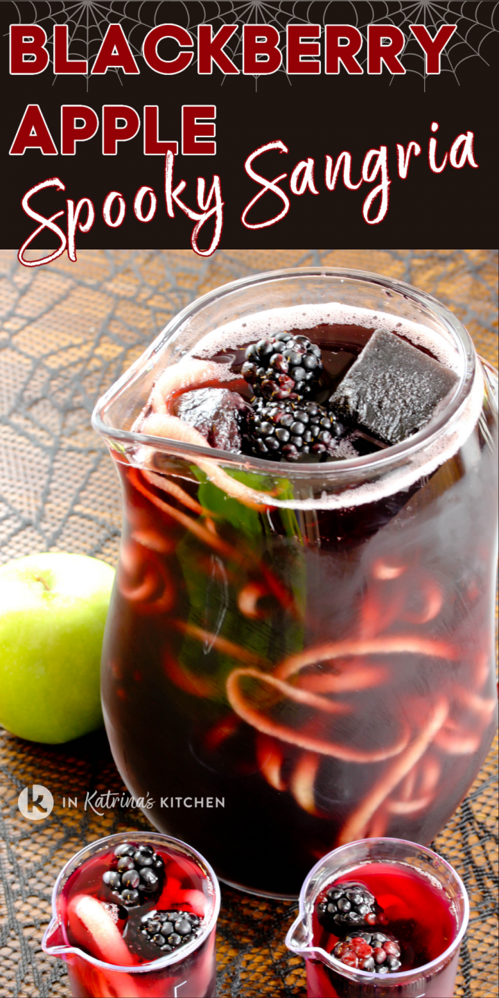pitcher of sangria shown with spiralized apples falling out of the top alongside glasses of sangria