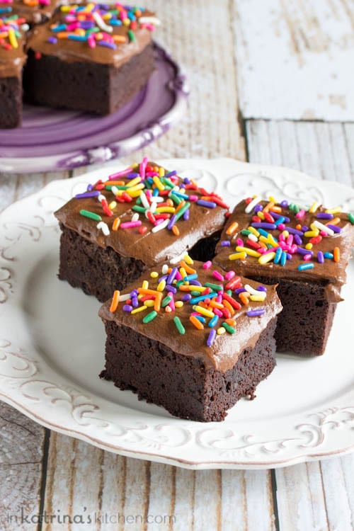 """Gluten-Free HERSHEY'S """"Perfectly Chocolate"""" Chocolate Cake Recipe with frosting and sprinkles"""