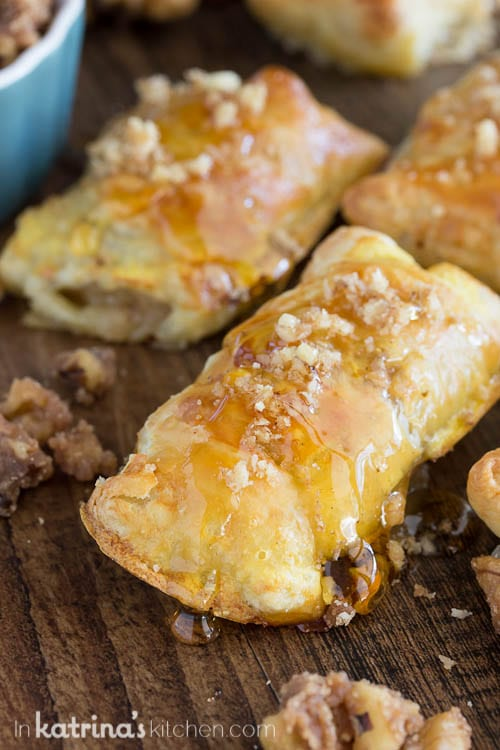 puff pastry appetizers shown drizzled with honey and sprinkled with candied nuts