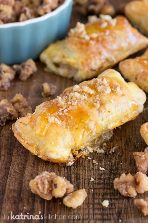 puff pasty appetizer drizzled with honey and candied walnuts