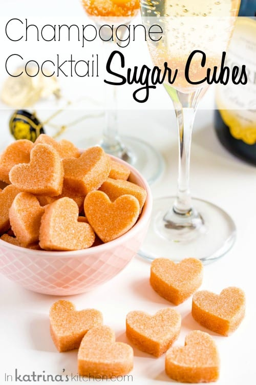 heart-shaped sugar cubes infused with angostura bitters shown in a pink bowl