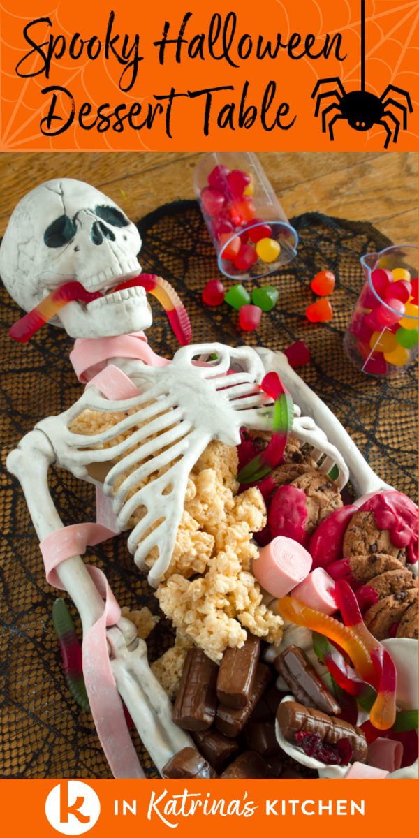 skeleton dessert table filled with candy