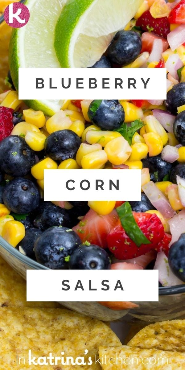 blueberry corn salsa close up served alongside corn chips and lime