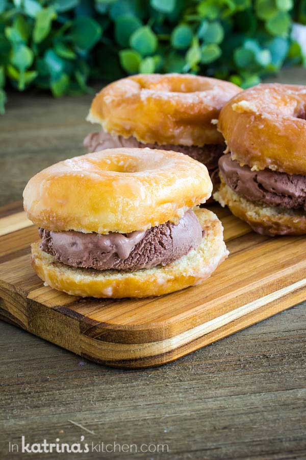 Chocolate Ice Cream sandwiched between a sliced donut