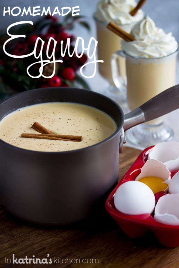 eggnog in a pot with cinnamon sticks and the text homemade eggnog