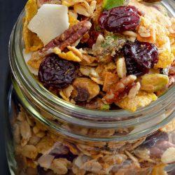 granola with cherris and coconut in a mason jar