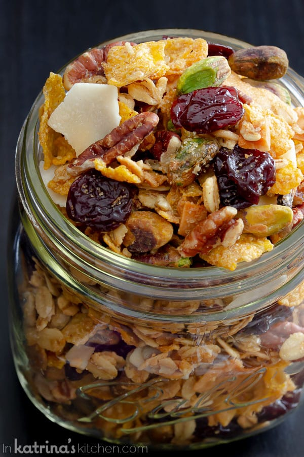 granola with cherris and coconut in a mason jar