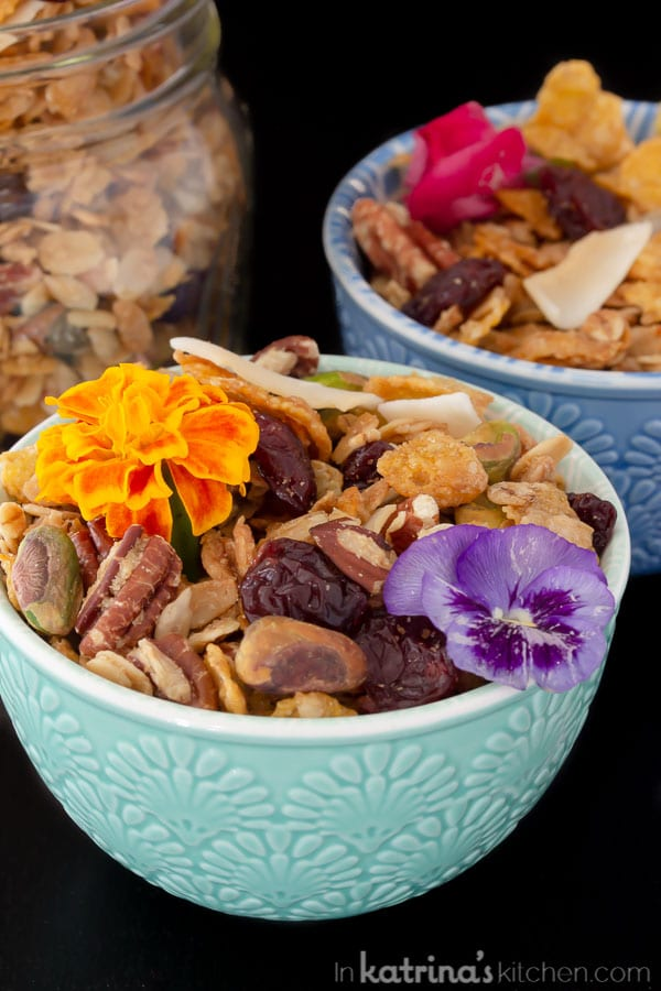 two small colorful bowls of granola with edible flowers