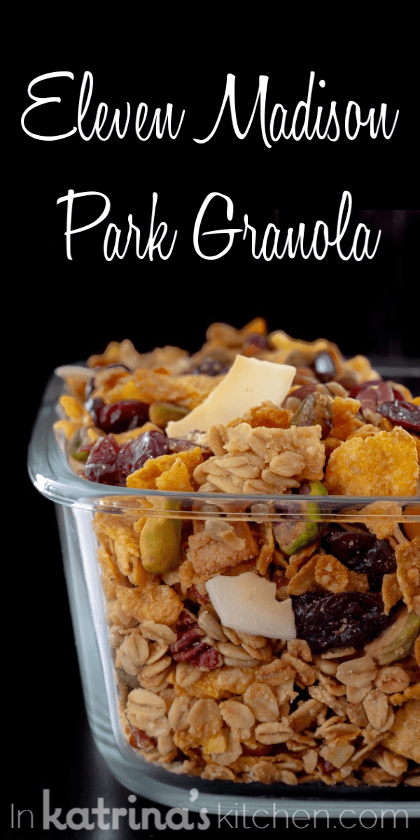 Eleven Madison Park Granola overflowing out of the top of a glass rectangular container