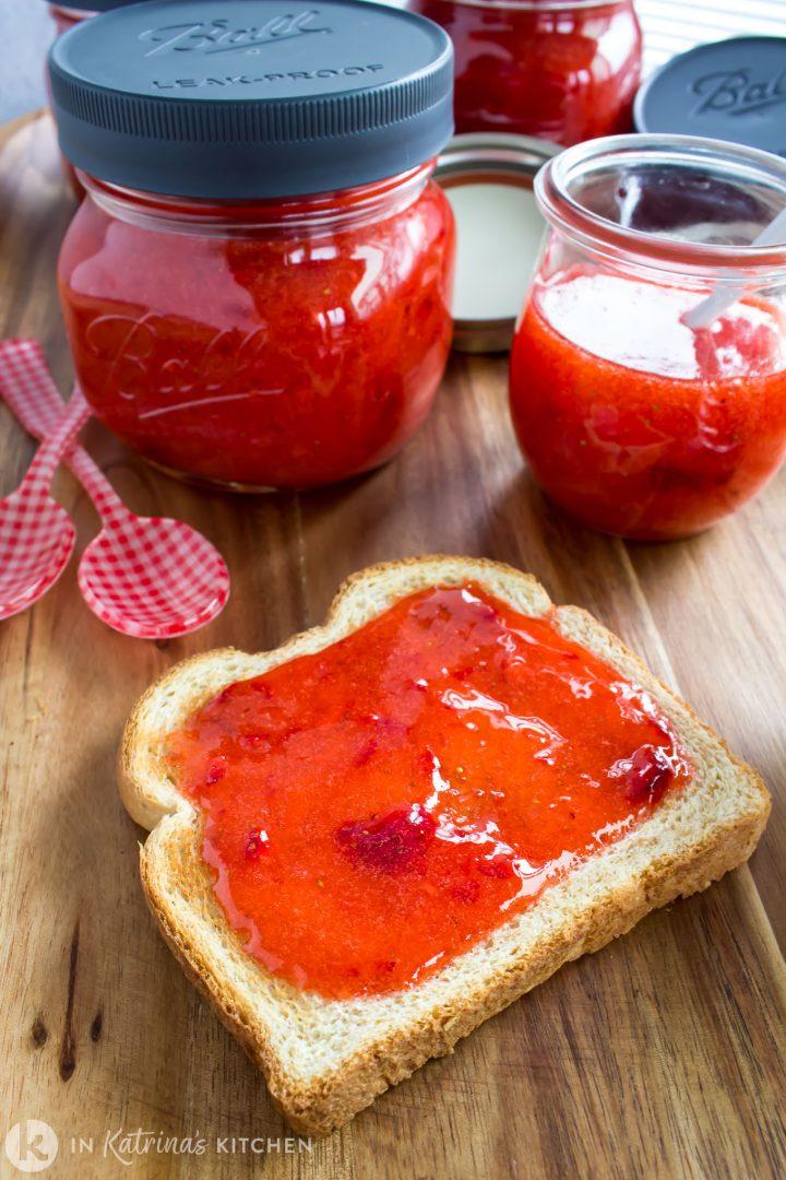 strawberry jam spread on wheat toast