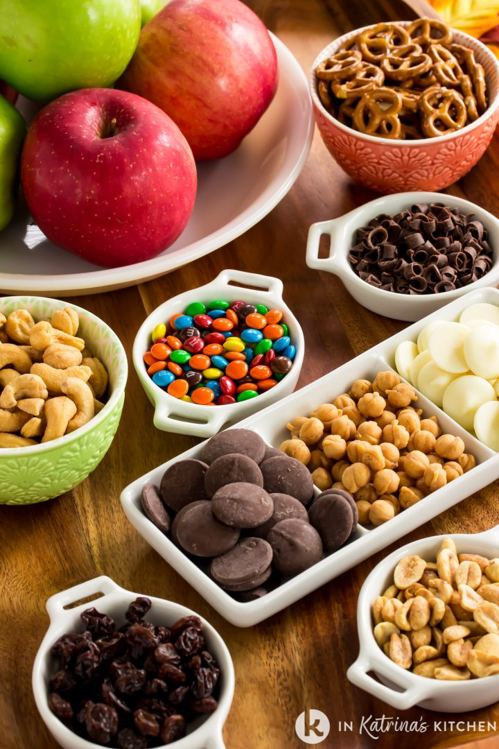 trail mix ingredients in small dishes