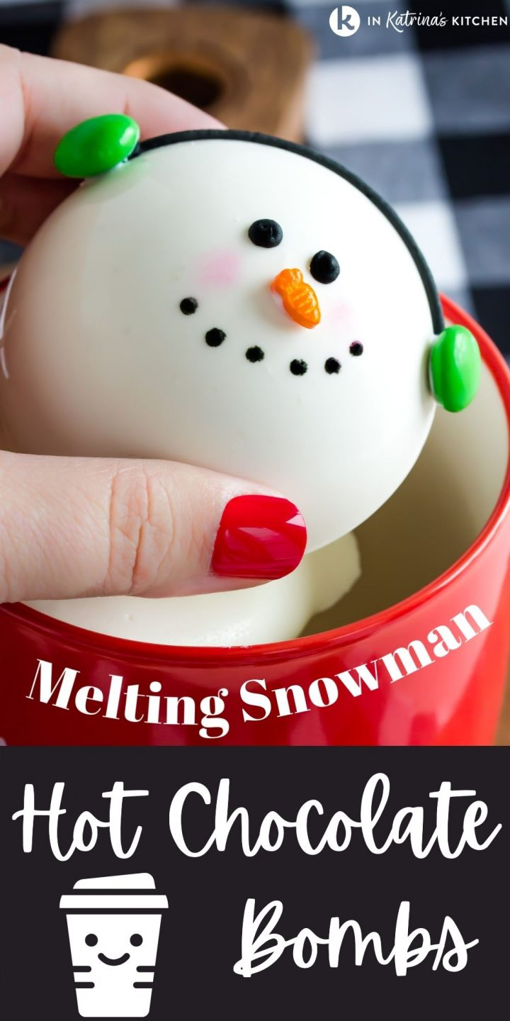 chocolate snowman being placed into a red mug