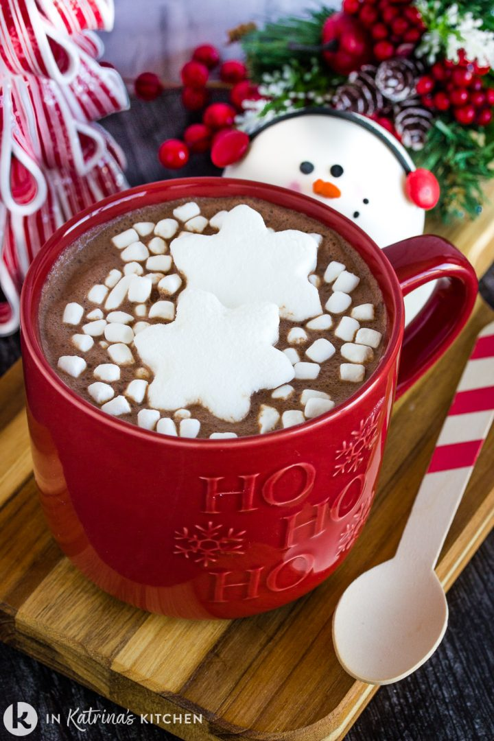 hot chocolate in a red mug with snowflake marshmallows