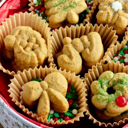 close up image of cookies in cupcake liners and an old fashioned cookie tin