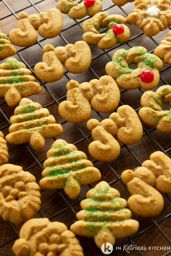rows of christmas cookies on a wire cooking rack