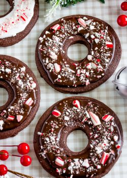 chocolate donut shaped cookies with a chocolate glaze and crushed peppermint