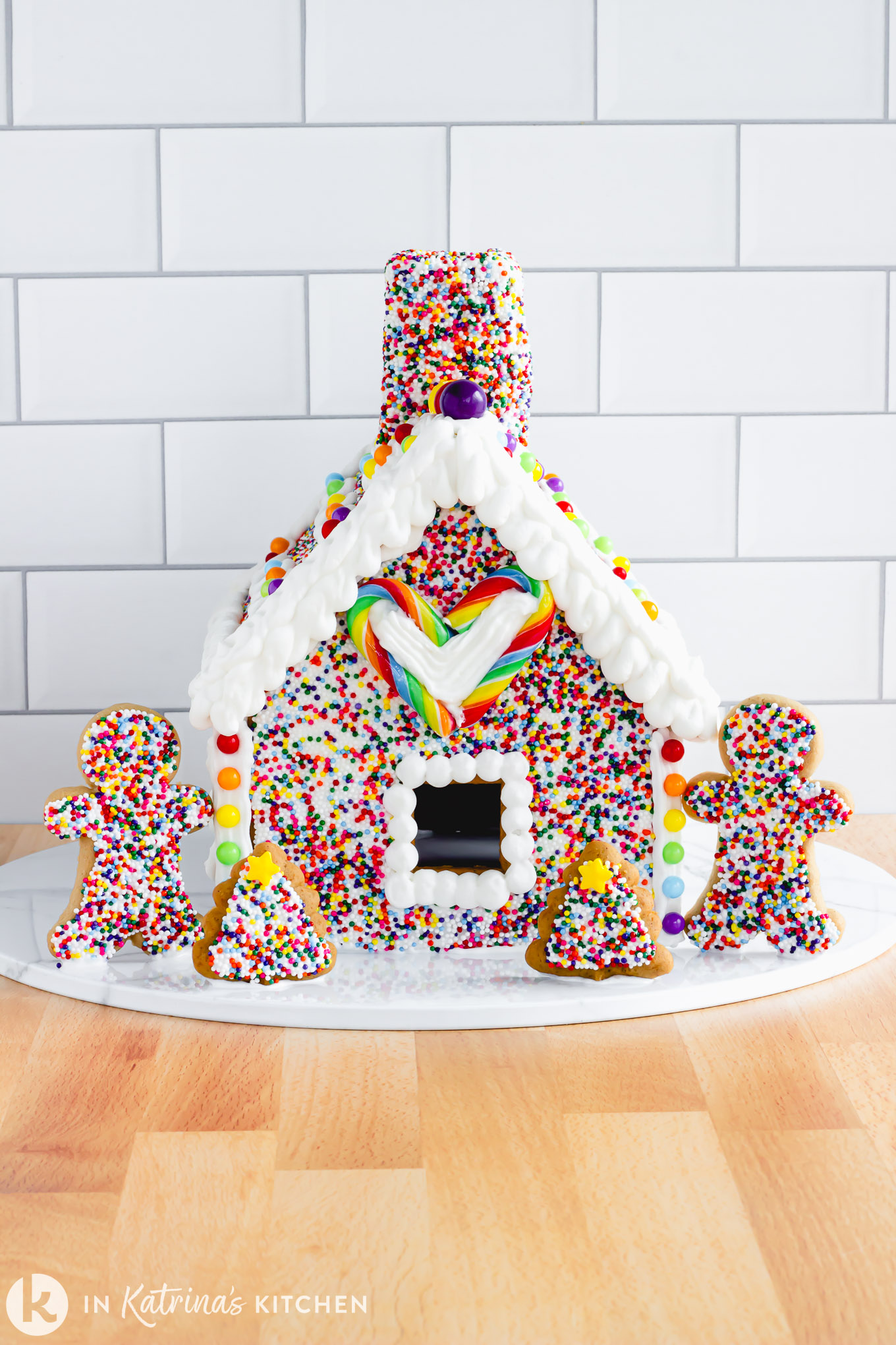 Make a Rainbow Sprinkle Gingerbread House this year. Not only is it whimsical and eye-catching, but it's easier to make than you might think! PRINT and PIN at In Katrina's Kitchen today.