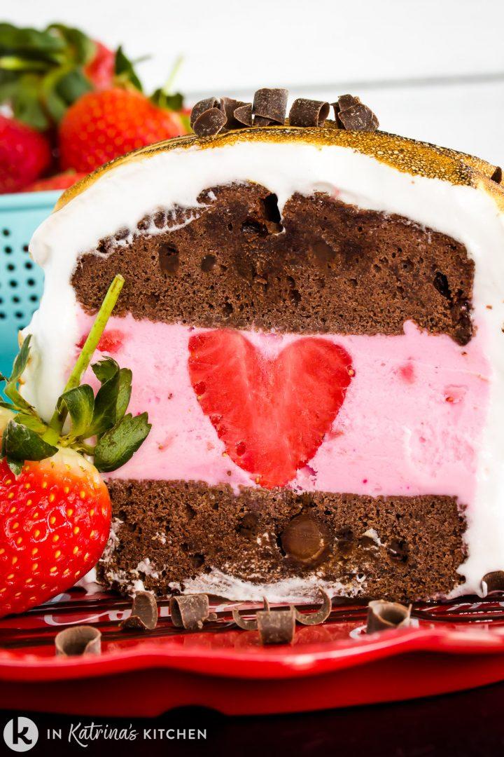 chocolate pound cake baked alaska with a heart shaped strawberry inside