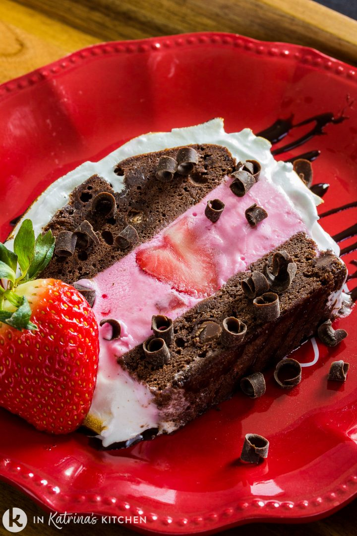 chocolate cake with strawberry ice cream and chocolate curls