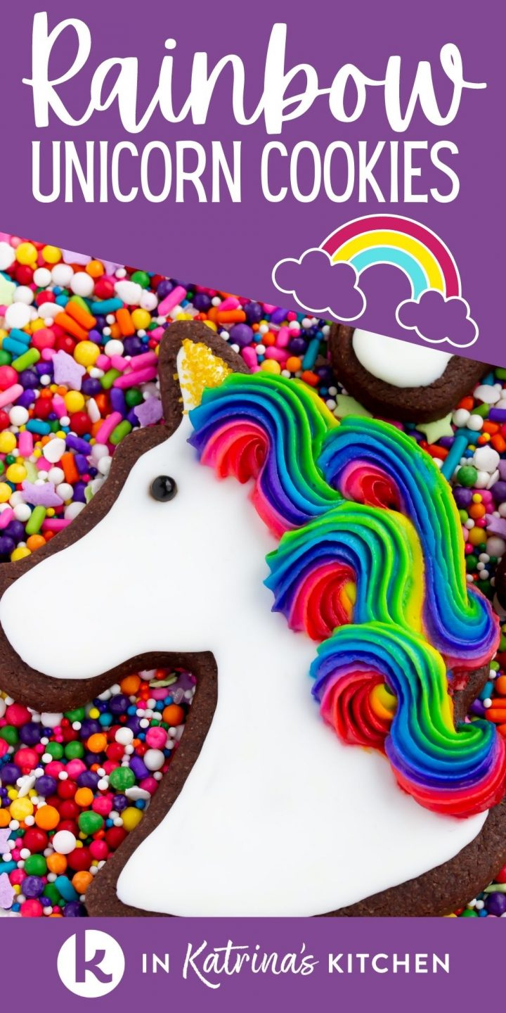 chocolate cut out cookies with rainbow icing on a plate of sprinkles with the text rainbow unicorn cookies