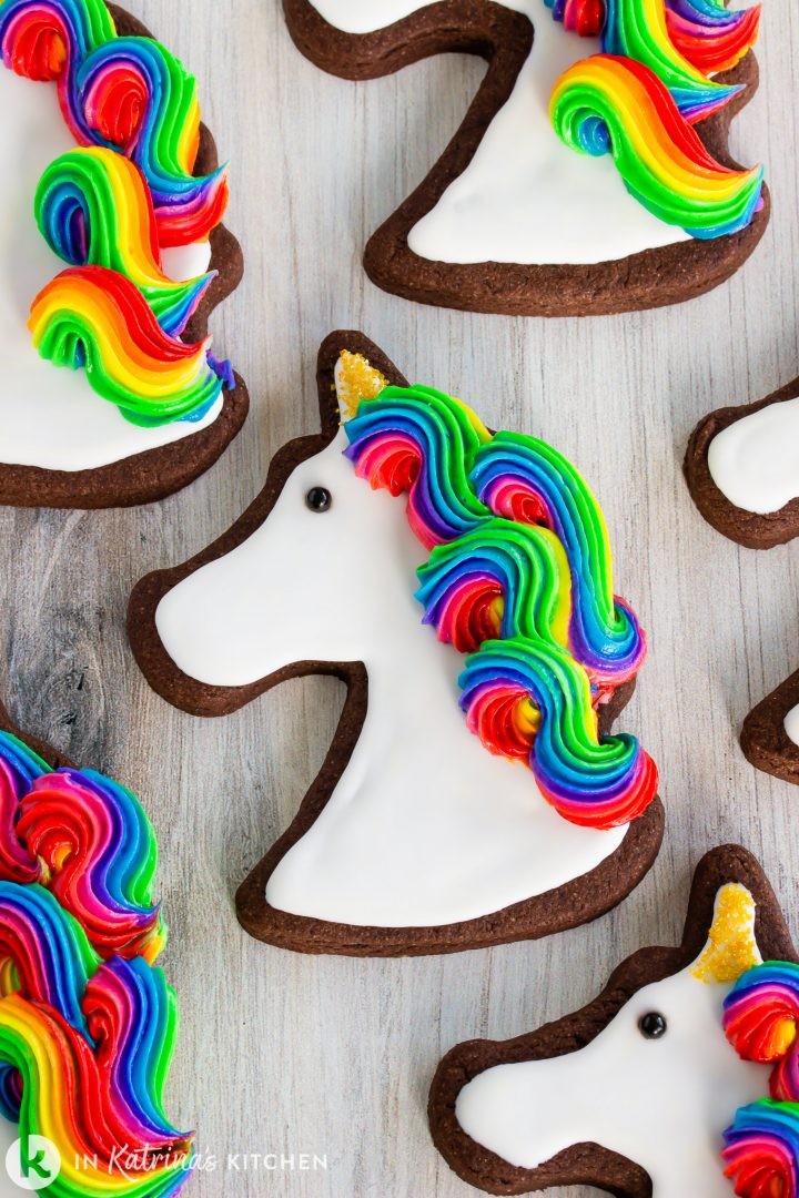 chocolate unicorn cookies with rainbow swirl icing