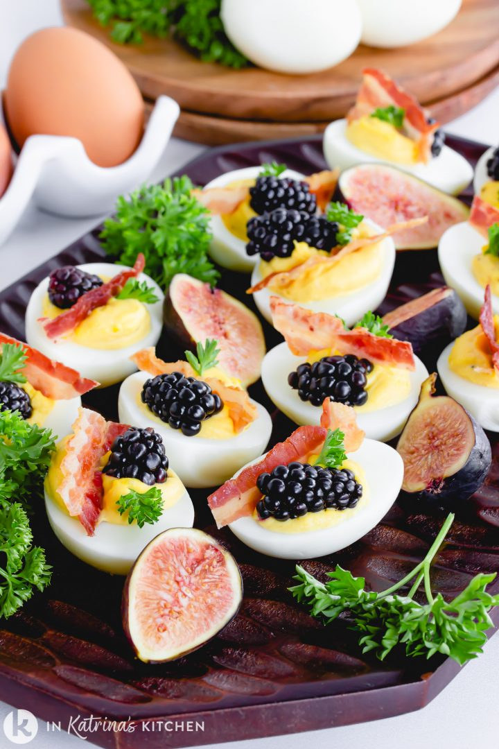 sweet deviled eggs with bacon, figs, and blackberries
