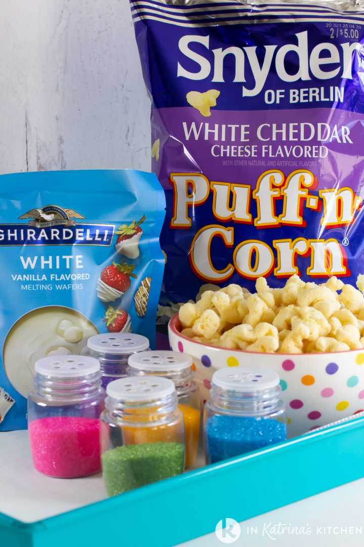 puff corn, white chocolate, and colorful sprinkles