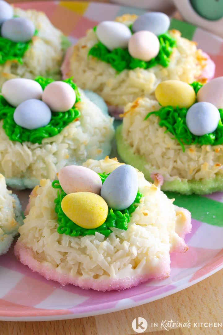 coconut macaroon cookies with pastel chocolate eggs on a checkered plate