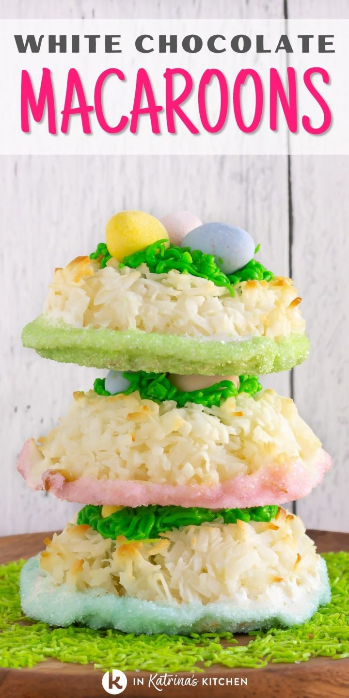 """three white chocolate coconut macaroon cookies stacked on top of one another on a bed of green sprinkles and text reading, """"White Chocolate Macaroons."""""""